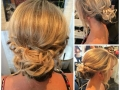 Casey gave this bridesmaid a chic messy bun with face framing fringe
