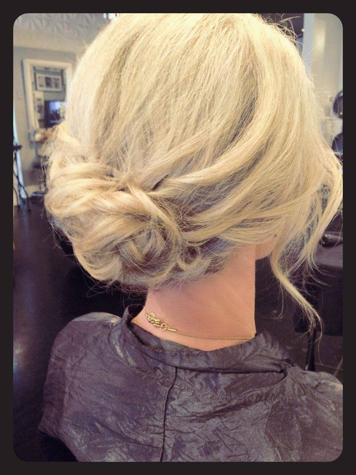 We love this soft modern updo created using Kevin.Murphy sewing kit.